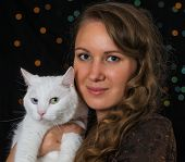 Woman And White Cat Portrait Over Bokeh