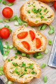 Bruschetta with cherry tomatoes and scallion
