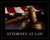 Attorney at law - wooden judge's gavel with flag in background.