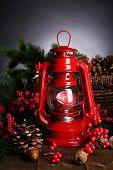 Red kerosene lamp on dark background