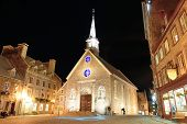 QUEBEC CITY, CANADA - SEP 10: Notre-Dame des Victoires at night in the day on September 10, 2012 in Quebec City, Canada. As the capital of Quebec, it is one of the oldest cities in North America.