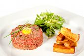 stock photo of tartar  - Beef tartare with fried potatoes and mix salad - JPG