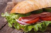 Ciabatta Sandwich With Ham And Vegetables Macro On Table.