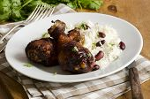 foto of jerks  - Jerk chicken with rice and beans on a plate - JPG