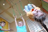 foto of children playing  - three happy 5 year old children playing together at home - JPG
