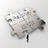 Partnership Puzzle Metal 3D And Businessman Icon As Concept