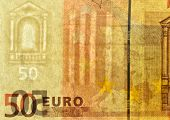 Watermark on fifty euro banknote. There is also vertical security strip inside paper on the right an