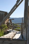 foto of chute  - Old cattle loading chute on a vintage barn on the Summer Lake in Central Oregon - JPG