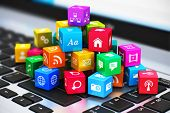 image of cube  - Macro view of heap of colorful cubes with application icons and symbols on laptop keyboard with selective focus effect - JPG