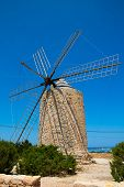 Formentera Windmill wind mill vintage masonry and wood in Mediterranean Balearic islands