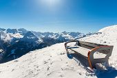Bench In Ski Resort  In Winter Snowy Mountains, Austria, Land Salzburg,  Austrian Alps -