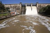 Expulsion of water after heavy rains in the reservoir of Puente Nuevo to Rio Guadiato near Cordoba A