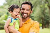 close up portrait of young indian father and baby boy outdoors