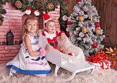 Happy Children With Christmas Gift Box Near Christmas Tree