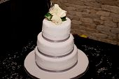 picture of three tier  - Beautiful three tier wedding cake on table