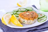 picture of patty-cake  - Salmon patty served with lemon and cucumber - JPG