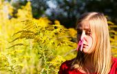 stock photo of ragweed  - Preventing inspiration of ragweed pollen because of allergy - JPG