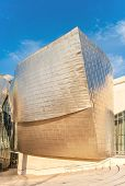 Facade Of The Famous Guggenheim Museum In Bilbao, Spain