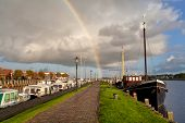Rainbow Over Zoutkamp Haven With Boats