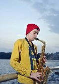 Modern Musician Posing With His Saxophone
