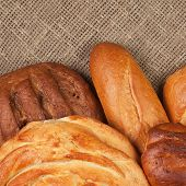 variety of fresh bread over sackcloth