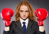 Woman boxer in dark room