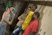 foto of peer-pressure  - Tough guys at school hanging around the locker - JPG