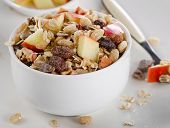 Muesli And Fruits For Breakfast In A White Bowl