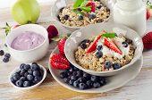 Muesli,  Ripe Berries And Yogurt For  Breakfast  On A Wooden Table