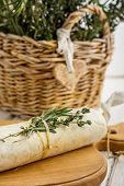 Butter with herbs in parchment paper folded
