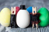 Easter Concept. Romantic Couple. Man, Woman And Colorful Easter Eggs. Clothespins. (soft Focus)