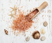 Sea Salt In Wooden Spoon With Sea Shells And Starfish