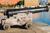 stock photo of cannon  - Old naval cannon 1819 harbor of La Spezia Liguria Italy - JPG