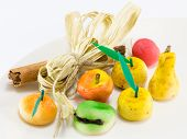 Sweet Marzipan Fruit Candies Dessert With Cinnamon Stick Decoration