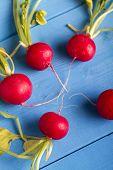 stock photo of radish  - Radish On Blue Wooden Background - JPG