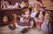 Cute charming little lady with dolls. Retro style.