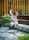 Boy takes a private moment to peel his Easter egg