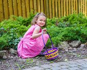 Girl Smiling During An Easter Egg Hunt