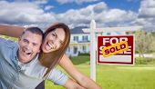 foto of excite  - Playful Excited Military Couple In Front of Home with Sold Real Estate Sign - JPG