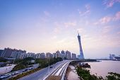 skyline and cityscape of modern city guangzhou during sunset at riverside