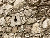 Ancient stone wall with loopholes