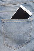 Smartphone In Back Pocket Of Blue Jeans