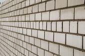 Background. Wall, vylazhennaya white silicate brick