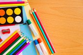 stock photo of arts crafts  - Colorful art supplies on a school desk with space for text - JPG