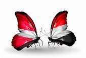 Two Butterflies With Flags On Wings As Symbol Of Relations Latvia And Yemen