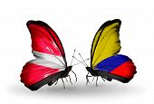 Two Butterflies With Flags On Wings As Symbol Of Relations Latvia And  Columbia