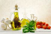 picture of olive shaped  - flavored olive oils with italian ingredients WITH BASIL - JPG