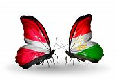Two Butterflies With Flags On Wings As Symbol Of Relations Latvia And Tajikistan