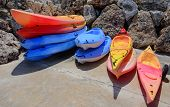 Stacks Of Colorful Kayaks