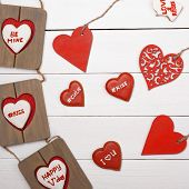 Sweet things for Valentine's Day. Wood heart, cookies, photo frame.